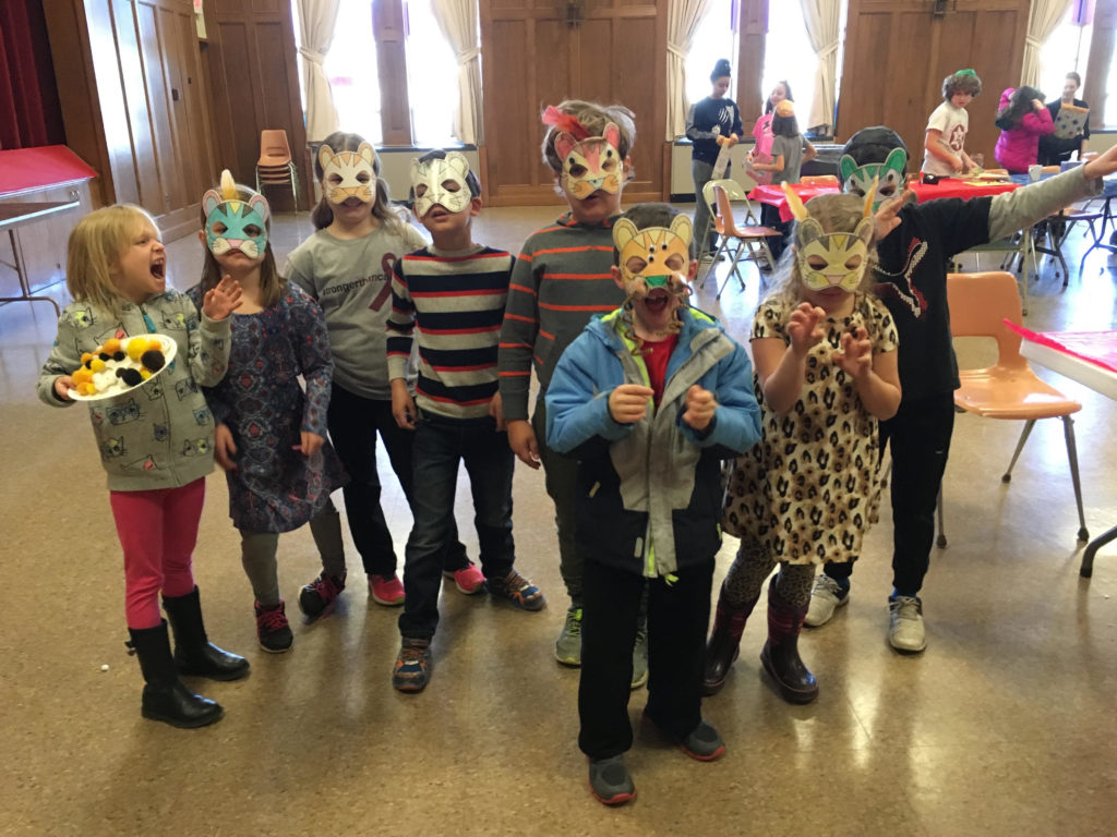The kindergarten and 1st grade class show off their (Passover) wild beast plague masks... Students had a wonderful time crafting items for the Seder: wild animal masks, matzah covers, and afikomen envelopes!